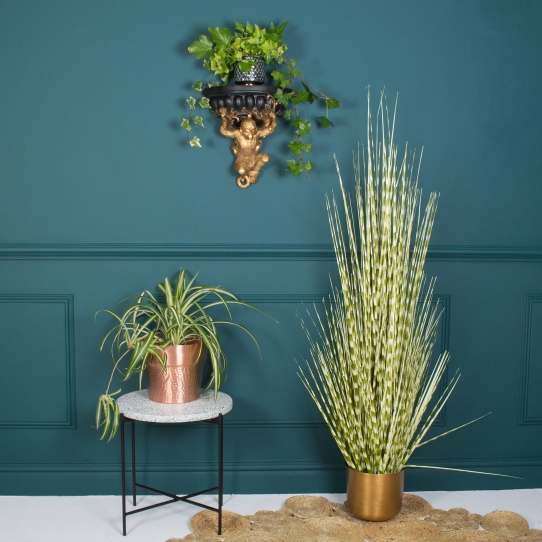 Faux Zebra Grass Plant £102. Monkey Wall Shelf £49. Terrazzo Table £195.